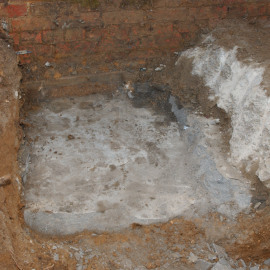 Further excavation into the second layer of mortar.