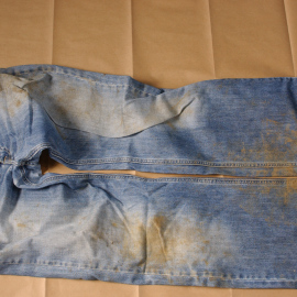 Mark's work jeans from 19 November 2009. These were forensically analysed for traces of the body or burial. None were found.