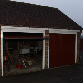 The detached, street-facing, double-door garage where Samuel's body was stored for a period of time. Whoever moved him would have had to do so in full view of the street.