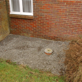 Close-up of one of the areas of underpinning at 2 Prospect Close. The concrete here has been gravelled over.