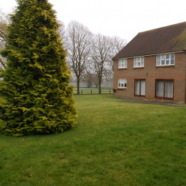 The back-garden of 2 Prospect Close. Notice how easy access from the neighbouring field is with just a small fence.